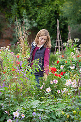 Removing perennials that have finished flowering from a border at the end of the season