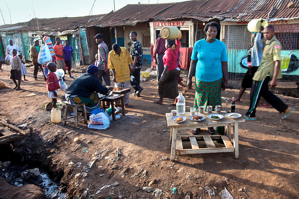 Roseline Amondi, a mother of four and microloan recipient with her day's worth of food outside her restaurant in the Kibera slum, Nairobi, Kenya.  (From the book What I Eat: Around the World in 80 Diets.) MODEL RELEASED.