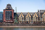 view over the river Rhine to the office building Silo 23, an old granary and to the old storehouse at the Rheinau Harbour, Cologne, Germany.<br /> <br /> Blick ueber den Rhein zum Buerogebaeude Silo 23 , ein alter umgebauter Getreidespeicher und zum zum alten Speicher, genannt Siebengebirg im Rheinauhafen, Koeln, Deutschland.