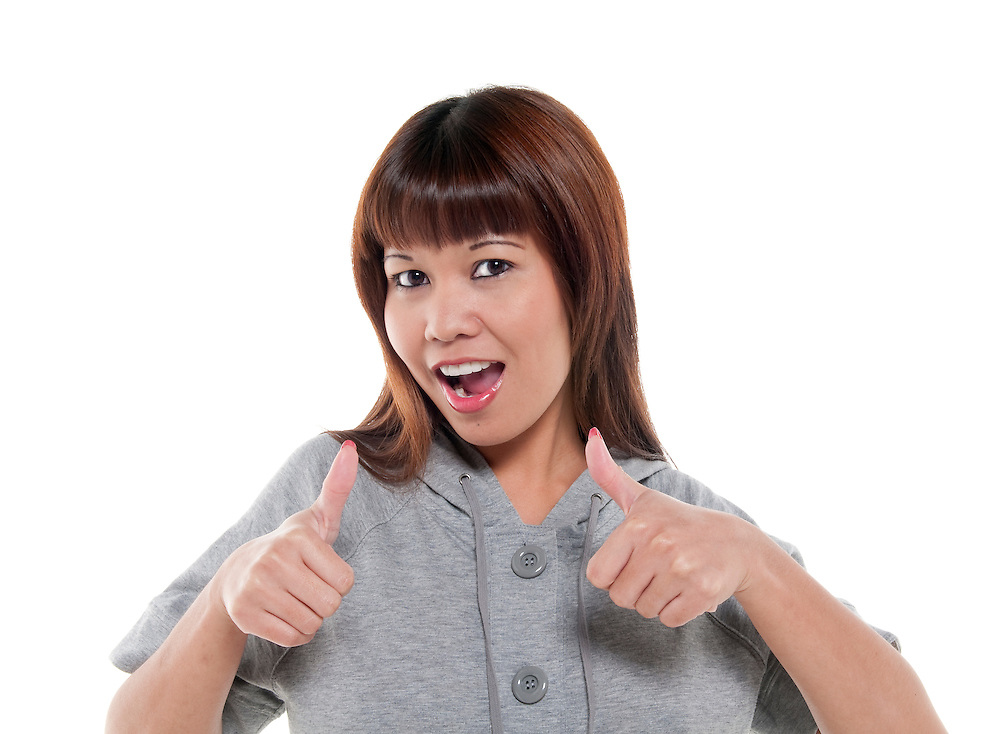 Young woman expressing positivity thumbs up very happy.