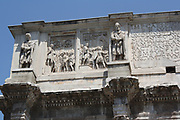 Sculptural and relief detail from The Arch of Constantine, a triumphal, or victory arch in Rome. It is positioned between the Collosseum and the Palatine Hill. It commemorates Emperor Constantine's victory in the Battle of Milvian Bridge in the early 4th century AD. It was dedicated in 315 AD and features reliefs/friezes documenting previous Emperors and victory figures.