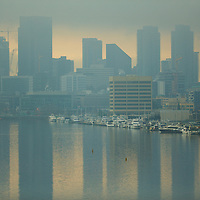 A winter morning in Seattle: low fog and a muted sunrise over the downtown buildings.