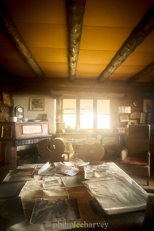 View of home interior with table, chairs and sunlight coming through window in Berghof Lodge in Bariloche, Argentina