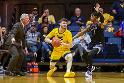 Feb 18, 2019; Morgantown, WV, USA; West Virginia Mountaineers guard Chase Harler (14) passes the ball during the first half against the Kansas State Wildcats at WVU Coliseum. Mandatory Credit: Ben Queen-USA TODAY Sports
