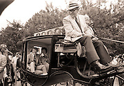 On the occasion of the US Bicentennial on July 4, 1976, candidate Jimmy Carter; his wife, Rosalynn; and daughter, Amy, ride<br /> in an 1850s carriage in Westville, Georgia, before speaking in front of a crowd of well-wishers.