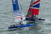 SailGP Team France helmed by Billy Besson crosses behind SailGP Team GBR helmed by Dylan Fletcher ahead of practice racing on the Solent. Event 4 Season 1 SailGP event in Cowes, Isle of Wight, England, United Kingdom. 8 August 2019: Photo Chris Cameron for SailGP. Handout image supplied by SailGP