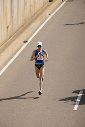 Deena Kastor on her way to victory at mile 24 after passing Magdalena Lewy Boulet to take command of the race
