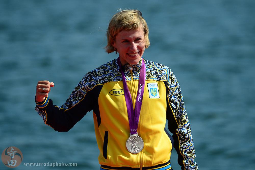 Aug 11, 2012; Windsor, United Kingdom; Inna Osypenko-Radomska (UKR) celebrates winning the silver medal in the women's kayak single K1 200m A final during the London 2012 Olympic Games at Eton Dorney.