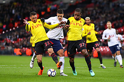 Tottenham Hotspur's Erik Lamela (centre) battles for the ball with Watford's Jose Holebas (left) and Christian Kabasele