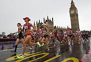 Mcc0041438 . Daily Telegraph..ST Sport..2012 Olympics..Runners passing Big Ben on Wesminster Bridge..The Woman's Marathon at the London 2012 Olympics..5 August 2012....