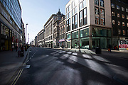 Oxford Street, Londons main shopping and retail area normally full of thousands of shoppers and traffic is virtually deserted due to the Coronavirus outbreak on 23rd March 2020 in London, England, United Kingdom. Following government advice most shoppers are staying at home leaving the streets quiet, empty and eerie. Coronavirus or Covid-19 is a new respiratory illness that has not previously been seen in humans. While much or Europe has been placed into lockdown, the UK government has announced more stringent rules as part of their long term strategy, and in particular social distancing.