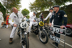 © Licensed to London News Pictures. <br /> 13/09/2019. <br /> Goodwood.West, Sussex. UK.<br /> The Goodwood Motor Circuit celebrates the 21st year of the Revival.This has become one of the biggest annual historic motorsport events in the world and the only one to be staged entirely in period dress. Each year over 150,000 people descend on this quiet corner of West Sussex to enjoy the three-day event.<br /> Pictured Before the start of the race, riders and mechanics with their classic Nortons.<br /> <br /> Photo credit: Ian Whittaker/LNP