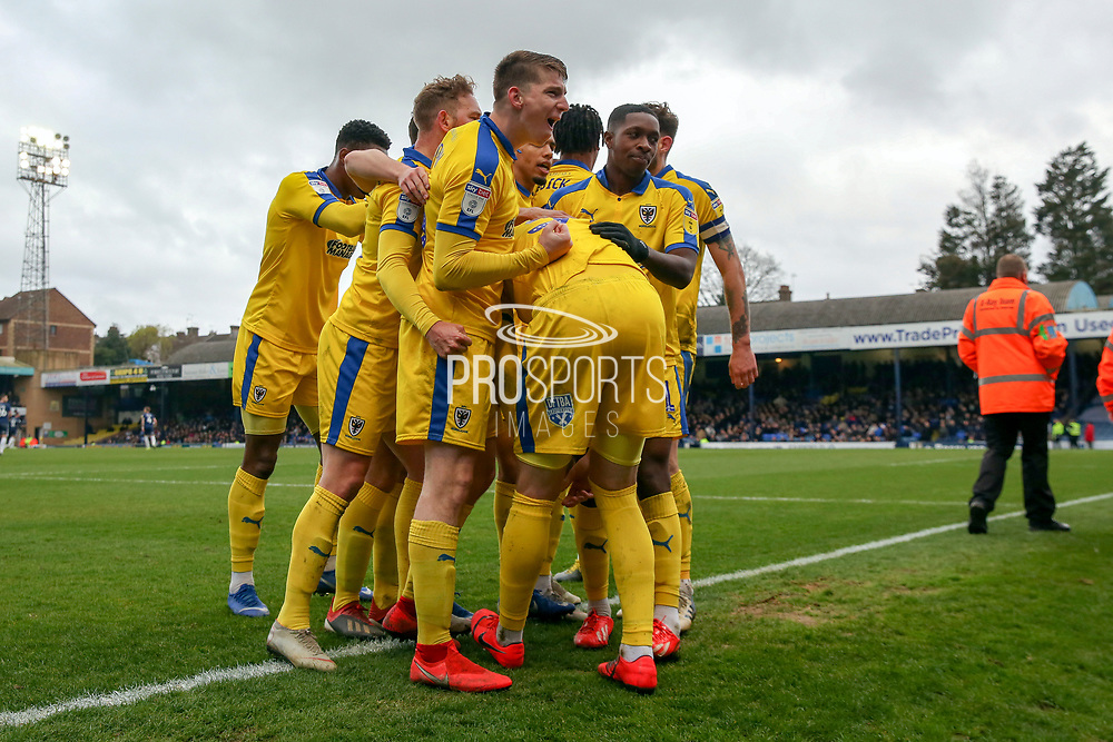 Players celebrating after AFC Wimbledon striker Joe Pigott (39) scores during the EFL Sky Bet League 1 match between Southend United and AFC Wimbledon at Roots Hall, Southend, England on 16 March 2019.