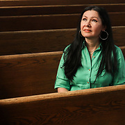 Linda Parra poses for a portrait in the sanctuary at Nuestra Gente Community Projects, which is based in a former church, in Toledo on Tuesday, May 11, 2021. Parra moved from Venezuela to Toledo in 2000, and she now runs a non-profit social services organization in the city's historic South End as well as an FM radio station that broadcasts in Spanish 24 hours a day. THE BLADE/KURT STEISS