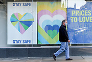 22nd February, Cheltenham, England. A man walks past Primark, one of the businesses shut during the ongoing national lockdown restrictions.