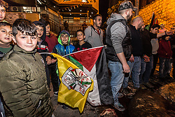 March 26, 2019 - Ramallah, Palestine Territories, Palestine - Palestinians children hold Palestinian and Fatah during street celebration after a member of their community has been released from Israeli prison after years sentence - Ramallah, Palestine on March 26, 2019. It is a local tradition to welcome freed prisoners in a festive fashion. To celebrate the event Palestinians killed several goats on the streets of Ramallah in a traditional fashion, by cutting the throat. Palestinians gathered on the street, played music, carried Palestinian and Fatah flags. (Credit Image: © Dominika Zarzycka/NurPhoto via ZUMA Press)