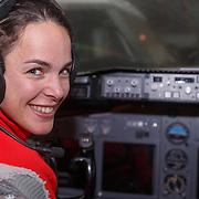 NLD/Amsterdam/20151021 - Ploegpresentatie Corendon schaatsploeg, Marrit Leenstra in een cockpit