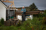 'Alex at work, 2018' from Colin McPherson's project 'Treasured Island' part of the Document Scotland exhibition entitled 'A Contested Land' which will launch at the Martin Parr Foundation, Bristol, on 16th January, 2019. McPherson's work was made in 2018-2019 on Easdale, the smallest permanently inhabited Inner Hebridean island and looks at the historical legacy of the island, once world famous for its slate mining industry.<br /> <br /> Photograph © Colin McPherson, 2018 all rights reserved.
