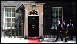 The British Prime Minister David Cameron greets US President Barack Obama on the steps of Number 10 Downing Street, London, On day 2 of his UK tour, Wednesday May 25,2011. Photo By Andrew Parsons / i-Images.