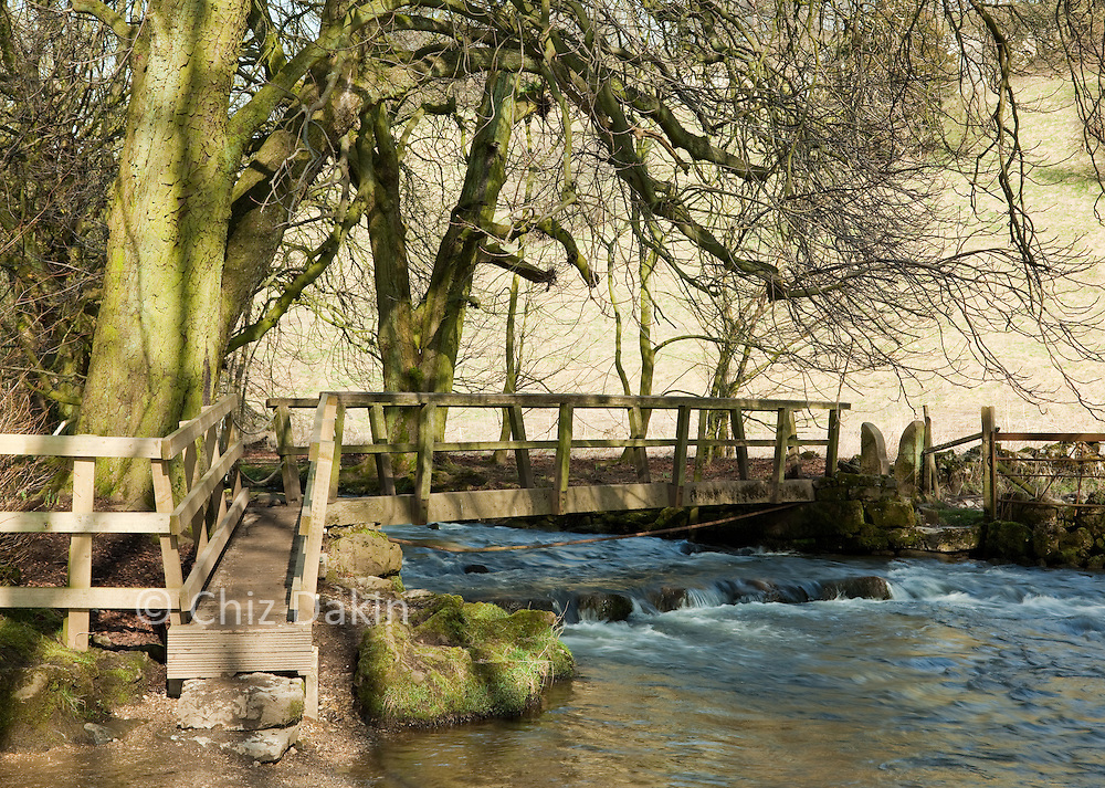 The footpath bridge crossing the R. Dove which marks the boundary between Beresford Dale and Wolfscote Dale, Peak District National Park