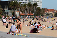 Two woman are seen in bikini's on the boardwalk at St Kilda Beach during COVID-19 in Melbourne, Australia. Premier Daniel Andrews comes down hard on Victorians breaching COVID 19 restrictions, threatening to close beaches if locals continue to flout the rules. This comes as Victoria sees single digit new cases. (Photo by Dave Hewison/Speed Media)