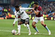 Swansea City midfielder Nathan Dyer (12) battles for possession  with Aston Villa defender Neil Taylor (3) during the The FA Cup 3rd round match between Aston Villa and Swansea City at Villa Park, Birmingham, England on 5 January 2019.