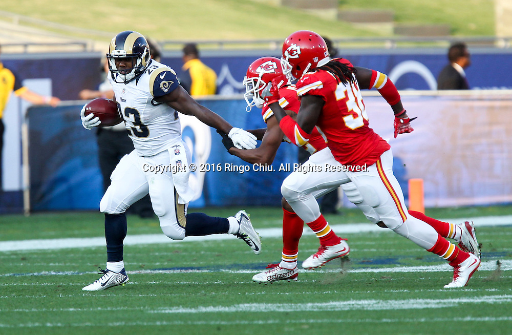 Los Angeles Rams Benny Cunningham #23 runs the ball fighting off pressure from Kansas City Chiefs during a preseason NFL football game, Saturday, Aug. 20, 2016, in Los Angeles. The Rams won 21-20. (Photo by Ringo Chiu/PHOTOFORMULA.com)<br /> <br /> Usage Notes: This content is intended for editorial use only. For other uses, additional clearances may be required.