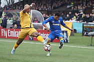 Early exchanges between Sutton United Simon Downer (27) and AFC Wimbledon striker Andy Barcham (17) during prior The FA Cup match between Sutton United and AFC Wimbledon at Gander Green Lane, Sutton, United Kingdom on 7 January 2017. Photo by Stuart Butcher.
