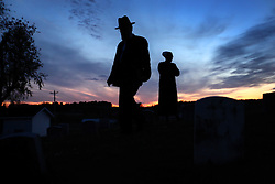 Jerry Schlabach and his wife visit the family cemetery plot in Berlin, Ohio, Oct. 12, 2009.