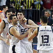 Fenerbahce Ulker's players (Left to Right) Darjus LAVRINOVIC, Omer ONAN, Emir PRELDZIC celebrate victory during their Euroleague Basketball Top 16 Game 2 match Fenerbahce Ulker between Power Electronics Valencia at Sinan Erdem Arena in Istanbul, Turkey, Thursday, January 27, 2011. Photo by TURKPIX
