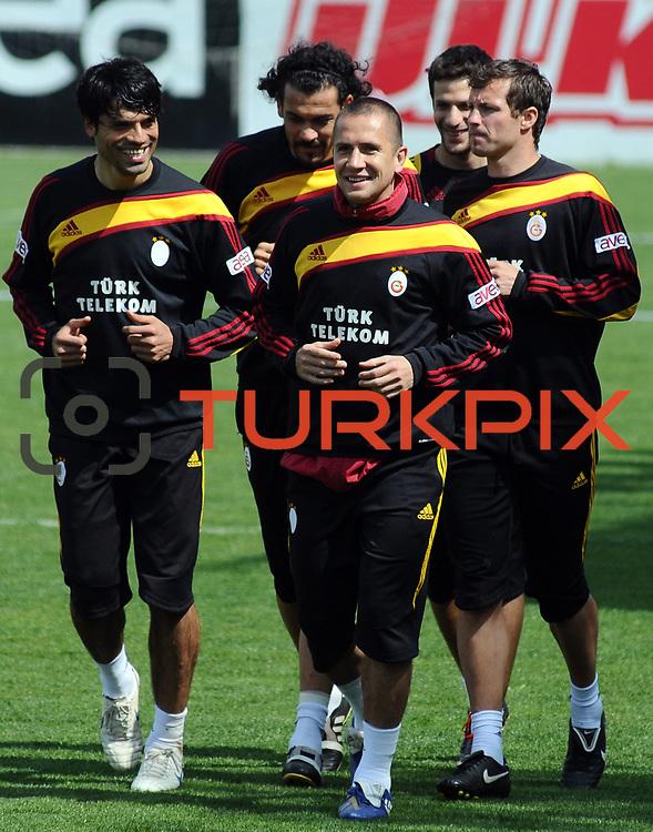 Galatasaray's players Gokhan ZAN (L) Emre ASIK (C), Lucas NEILL (R), Servet CETIN (B) Hakan BALTA (B) during their training session at the Jupp Derwall training center, Tuesday, April 20, 2010. Photo by TURKPIX