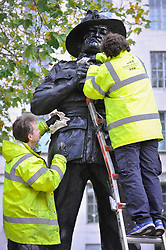 © Licensed to London News Pictures. 08/11/2017. London, UK.  Workmen clean the bronze statue of Field Marshall The Viscount Slim, one of several war statues in Whitehall, as preparations for Armistice Day and Remembrance Sunday continue in, and around, Westminster.  Photo credit: Stephen Chung/LNP