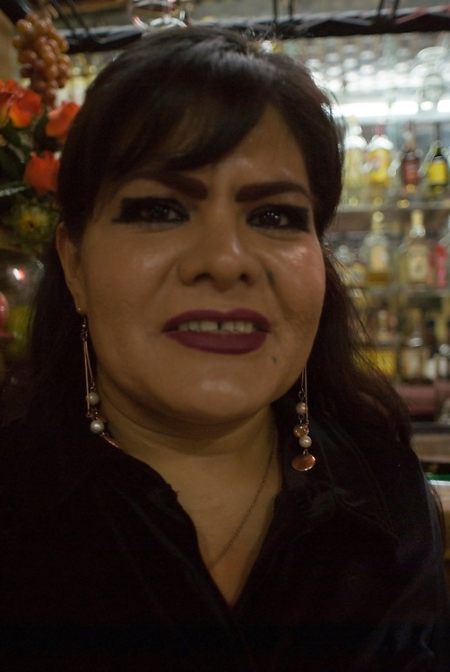 portrait of Maria, the barmaid at cantina El Jarrito. Photos from night bike ride in Mexico City's historic center with Luis Mdahuar and Mike Smith. Mexico DF, Tuesday May 1, 2007
