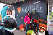 AARP's Robert Harvey at the photo booth with attendees Amadita and Freddie Diaz at the AARP Block Party at the Albuquerque International Balloon Fiesta in Albuquerque New Mexico USA on Oct. 7th, 2018.