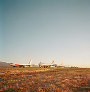 In mid-day heat of the arid Sonoran desert sit the remains of a Boeing airliner sat the storage facility at Mojave, California. Here, the fate of the world's retired civil airliners is decided by age or a cooling economy and are either cannibalised for still-working parts or recycled for scrap, their aluminium fuselages worth more than their sum total. After a lifetime of safe commercial flight, wings are clipped and cockpits sliced apart by huge guillotines, cutting through their once-magnificant engineering. Picture from the 'Plane Pictures' project, a celebration of aviation aesthetics and flying culture, 100 years after the Wright brothers first 12 seconds/120 feet powered flight at Kitty Hawk,1903.