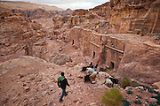 Bedouin shepherd Atala Mohammed herds his goats through the canyons of Petra, Jordan.