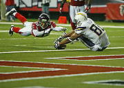 ATLANTA - AUGUST 29:  Wide receiver Malcom Floyd #80 of the San Diego Chargers recovers a fumble at the goal line as cornerback Brett Grimes #20 of the Atlanta Falcons dives to gain possession during the game at the Georgia Dome on August 29, 2009 in Atlanta, Georgia.  The Falcons beat the Chargers 27-24.  (Photo by Mike Zarrilli/Getty Images)