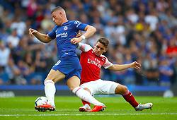 Chelsea's Ross Barkley (left) and Arsenal's Lucas Torreira battle for the ball