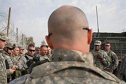 Soldiers from the 1st Infantry, 17th Regiment, gather before patrolling western Mosul, Iraq, Dec. 15, 2005. This is part of an effort to provide security in preparation for Iraq's first  post-Saddam parliamentary elections. The western sector is home to Mosul's primarily Sunni population, which has been resistant to the American presence in Iraq.