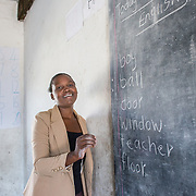 INDIVIDUAL(S) PHOTOGRAPHED: Judith Banda. LOCATION: Chibolya Community School, Chibolya, Lusaka, Zambia. CAPTION: Community leader Judith Banda at Chibolya Community School in Lusaka. A block of classrooms was constructed at the school as part of Build It International's Training into Work & Community Building programme. Build It International is a charity that trains unemployed young people in Zambia to become builders, while at the same time building vital schools and clinics in communities with little or nothing by way of resources.