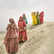 """Pilgrims circumnavigating one of the volcano. The area around Chandragup (meaning """"Moon Well""""), a sacred site to Hindu of 3 mud volcanoes (mainland Asia's largest ones)."""