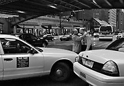 Two cab drivers argue in front of Grand Central Station in New York during rush hour, Tuesday, January 31, 2006.