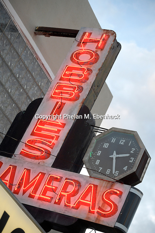 A neon sign sits above the front entrance to a business in the Mills 50 district of Orlando, Fla., Friday, Oct. 14, 2016. (Photo by Phelan M. Ebenhack)
