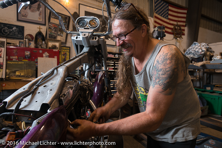 Bean're tearing his motor apart to replace a blown head gasket at his buddy's Blings Cycle shop during Daytona Bike Week 75th Anniversary event. FL, USA. Friday March 4, 2016.  Photography ©2016 Michael Lichter.