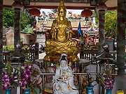 26 AUGUST 2014 - BANGKOK, THAILAND:  An altar the Gong Wu Shrine in Bangkok. Gong Wu is an ancient shrine dating back over 270 years and is located on the Thonburi side of the Chao Praya River in Somdet Ya (Princess Mother Community), Khlong San area of Bangkok. The first of the 3 Gong Wu statues was brought to Thailand around 1736 by Hokkien Chinese traders. On site there are 3 primary temple buildings of various ages.   PHOTO BY JACK KURTZ