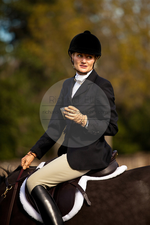 A fox hunter enjoys a glass of port before the start of the foxhunt on the greensward of Charleston Place plantation in Charleston, South Carolina. The hunt is a drag hunt where a scented cloth is used instead of live fox.