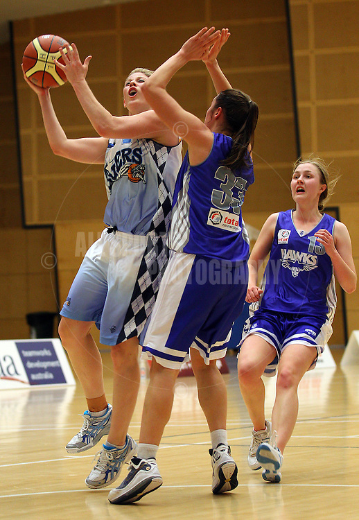PERTH, AUSTRALIA - JULY 16: Melissa Marsh of the Tigers lays up against Gabby Clayton of the Hawks during the week 18 SBL game between the Perry Lakes Hawks and the Willetton TIgers at The State Basketball Center on July 16, 2011 in Perth, Australia.  (Photo by Paul Kane/All Sports Photography)
