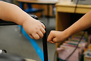 Classmates bump fists with Noah Stout, 7, as he says goodbye after his first visit to Hilary Leday's second grade class since being diagnosed with Diffuse Intrinsic Pontine Glioma (DIPG), a rare and non-operable tumor located on the brain stem, at Sinnott Elementary School in Milpitas, California, on August 29, 2013. Noah's treatments make his arms and legs weak, so it is difficult to lift and grab items or shake hands. (Stan Olszewski/SOSKIphoto)