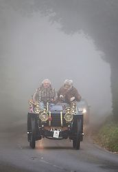 © Licensed to London News Pictures. 01/11/2015. Staplefield, UK. A 1902 De Dietrich drives along a foggy road near Staplefield as it takes part in the London to Brighton Veteran Car Run.  Photo credit: Peter Macdiarmid/LNP