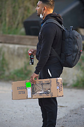 ©Licensed to London News Pictures 10/09/2020  <br /> Orpington, UK. A police officer carrying an evidence box. Police continue to search a traveller site in Orpington, South East London today after one of the biggest armed police operations in the UK. The site and local roads are under Met police control with a large cordon in place. Photo credit:Grant Falvey/LNP
